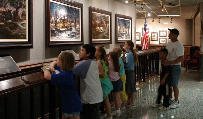 A group of all ages enjoying the art.
